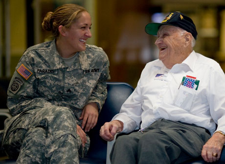 Bill Knight talking with a female soldier at the airport.