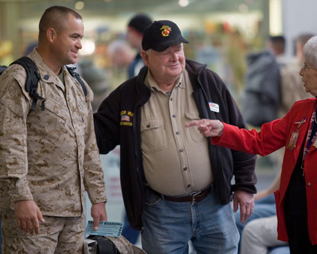 POV's The Way We Get ByJerry Mundy speaking with a GI and fellow troop greeter at the airport.