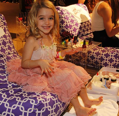 Little actress Grace McKenny getting her tiny nails polished in the mini spa.