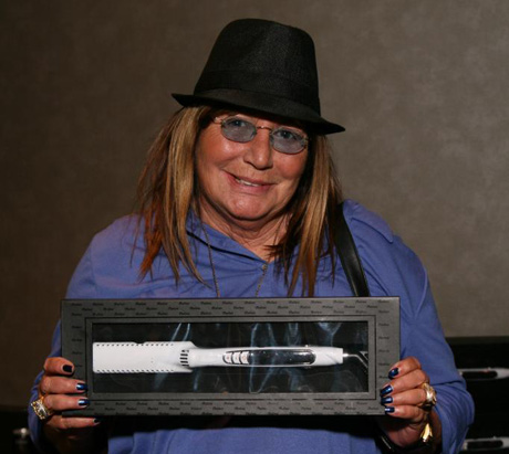 Producer Penny Marshall with Barbar Hair Tools new Titanium Flat Iron