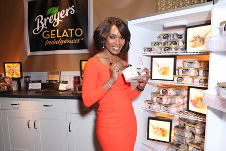 Angela Bassett at the Breyer's Indulgence Gelato having a taste.