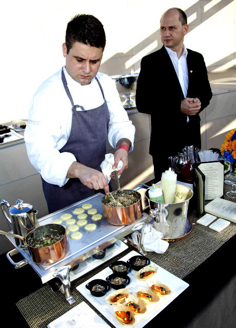 Brandon Weaver, Chef de Cuisine of The Roof Garden, The Peninsula Beverly Hills prepares Truffle Macaroni and Cheese from the Suite 100 special menu.