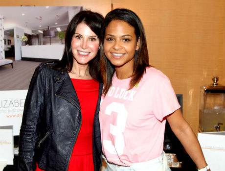 Christina Milian (R) and Dentist