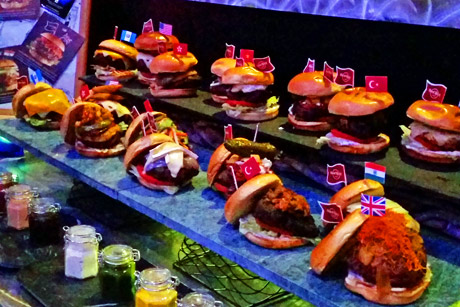 An array of amazing burgers representing cities & countries all over the globe.