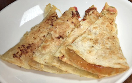 FishBar's Lobster Stuffed Quesadilla has delicate lobster meat nestled between decadent cheese in a flour tortilla. Delicious!