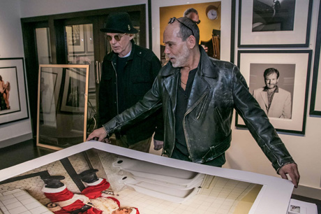 Billy Bob Thornton with Timothy White signing his Bad Santa poster.