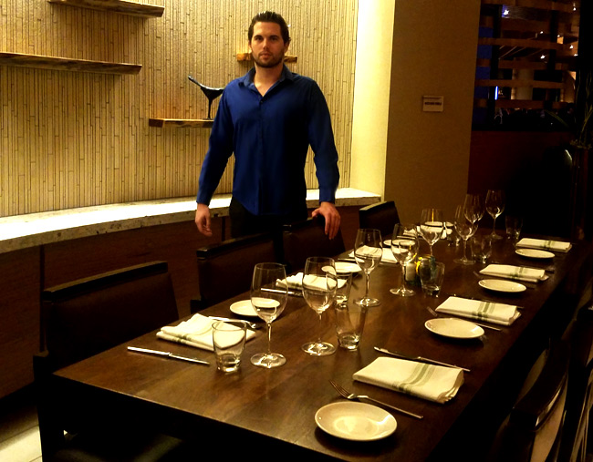 Tyler Emery checks out one of the few private dining rooms at Marina Kitchen.