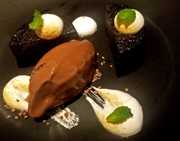 This flourless chocolate cake with the most diving chocolate pepperment ice cream and marshmallow is unforgettable!