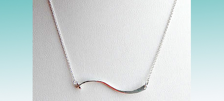 Designs by Diane gifted her Maui Wave necklace in sterling silver.