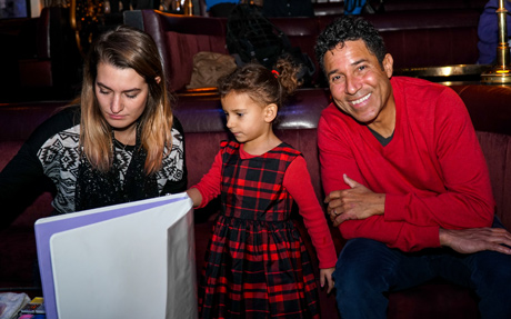 Oscar Nunez and his daughter August check out the face painting - Photo: Igor Spector