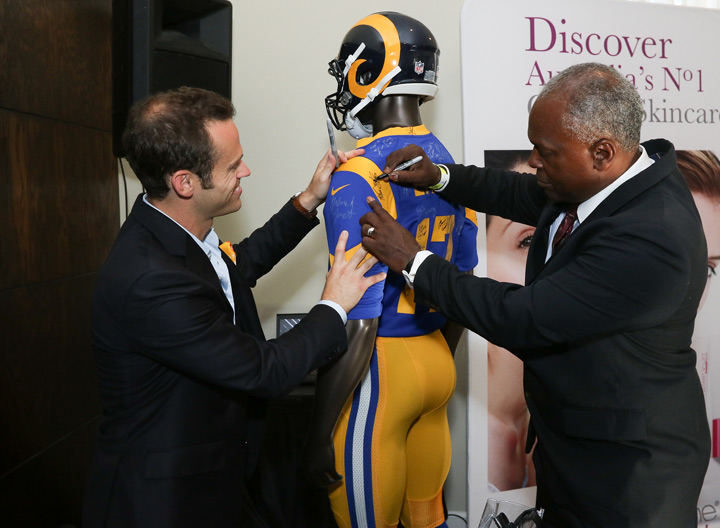 Actor Danny Glover signing LA Rams jersey for charity.