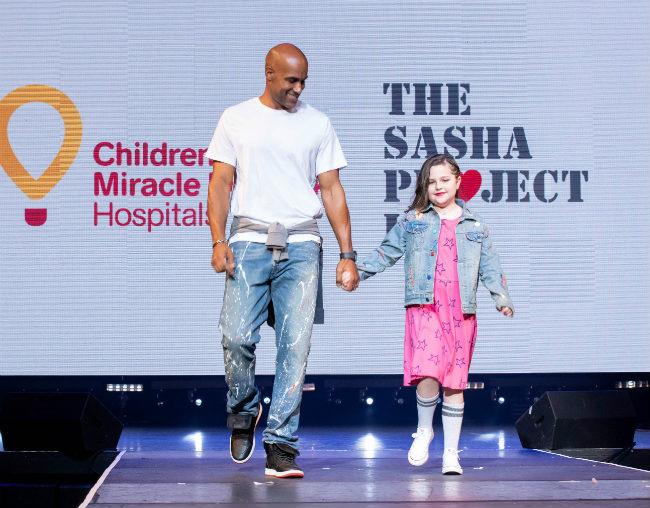 Boris Kodjoe & Miracle Kid Chloe rock the runway--Toni Love