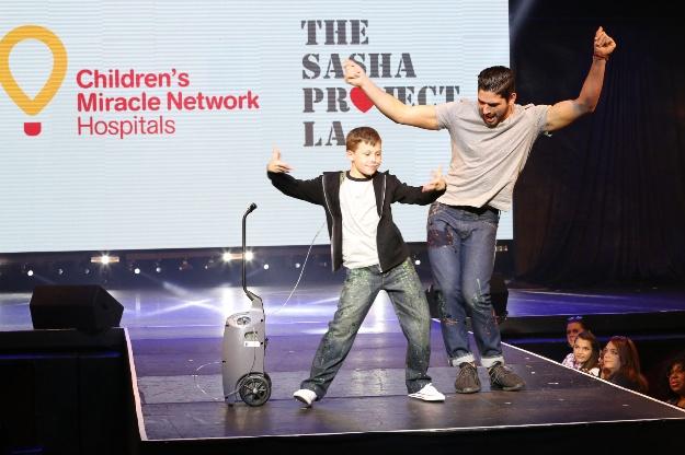 Miracle Kid Nate & Alan Bersten rock the runway