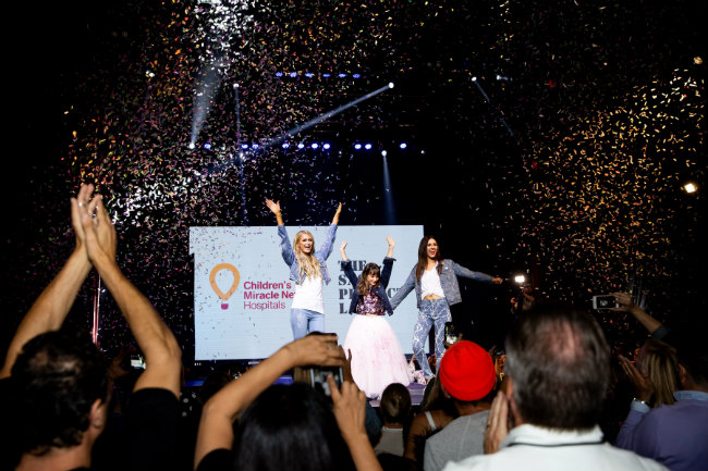 Paris Hilton and Victoria Justice and Miracle Kid Sasha Bogoisian at the finale of the Rock The Runway fashion show--BrianaHodge