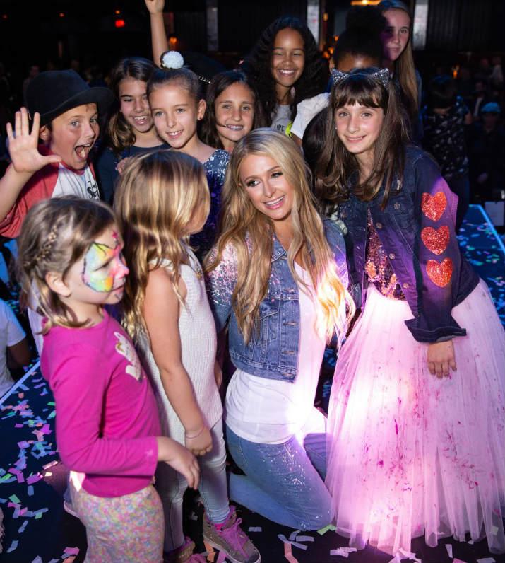 Paris Hilton with Miracle Kid Sasha Bogosian and guests--Photo: Briana Hodge