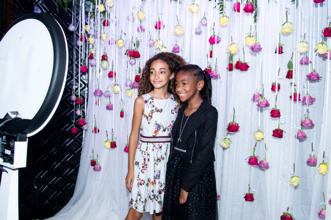 Sophia Pippen & Miracle Kid JaKiah have fun in the Polite In Public photo booth with a custom floral backdrop by The Bouqs--Toni Love